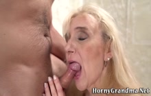 Mature whore gives head and strokes